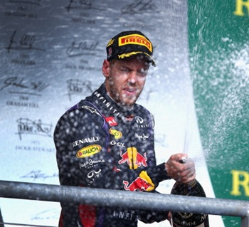 Sebastian Vettel of Germany and Infiniti Red Bull Racing celebrates on the podium after winning the United States Formula One Grand Prix at Circuit of The Americas
