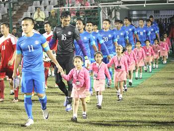 Sunil Chhetri leads the Indian team out against Nepal on Tuesday