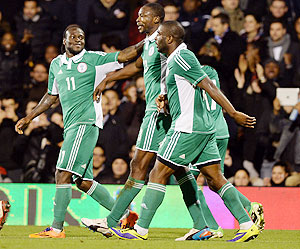 Shola Ameobi of Nigeria (C) celebrates scoring the second goal during the international friendly match between Italy and Nigeria at Craven Cottage in London on Monday