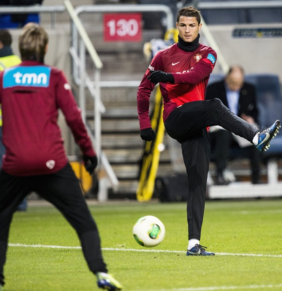 Portugal's Cristiano Ronaldo (right) takes part in a training session at the Friends Arena in Stockholm