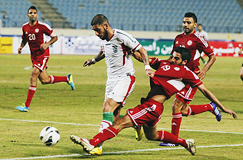 Lebanon's Ali Hamam (R) fights for the ball with Iran's Ashkan Dejagah during their AFC Asian Cup 2015 qualifying soccer match in Beirut on Tuesday