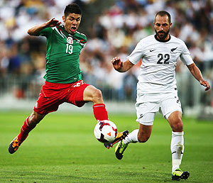 Oribe Peralta of Mexico reaches out for the ball past Andrew Durante of New Zealand during leg 2 of the FIFA World Cup Qualifier at Westpac Stadium in Wellington, on Wednesday