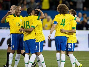 Brazil forward Robinho celebrates scoring a goal with Brazil midfielder Paulinho (18) during the second half in a friendly match against Chile at Rogers Centre in Ontario, Canada