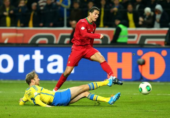 Cristiano Ronaldo scores Portugal's second goal during the FIFA 2014 World Cup Qualifier Play-off second leg match against Sweden at Friends Arena in Stockholm