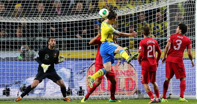 Zlatan Ibrahimovic (centre) heads Sweden's equalizing goal