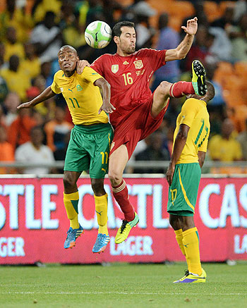Sergio Busquets of Spain wins the header during the International friendly match between South Africa and Spain at Soccer City Stadium in Johannesburg on Tuesay