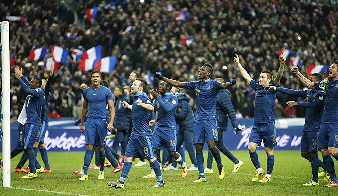 France's players celebrate after winning their 2014 World Cup qualifying second leg playoff match against Ukraine at the Stade de France in Saint-Denis near Paris on Tuesday