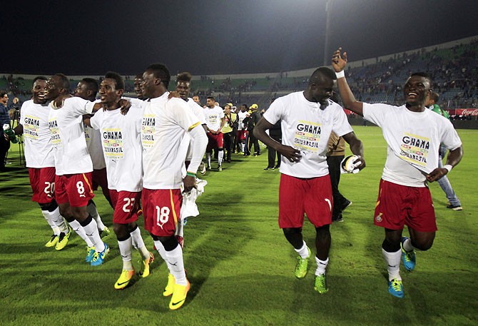 Ghana's soccer team players break into a jig as they celebrate after their 2014 World Cup qualifying second leg playoff match against Egypt at Air Defence 30 June stadium in Cairo, on TUesday
