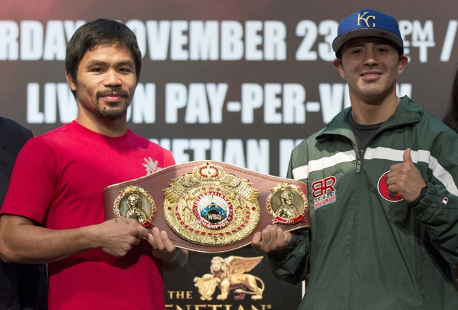 Filipino boxer Manny Pacquiao (left) and Brandon Rios of the US