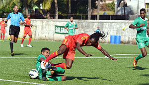Pune FC striker Riga Mustapha (right) is challenged by an opponent during their I-League match on Friday