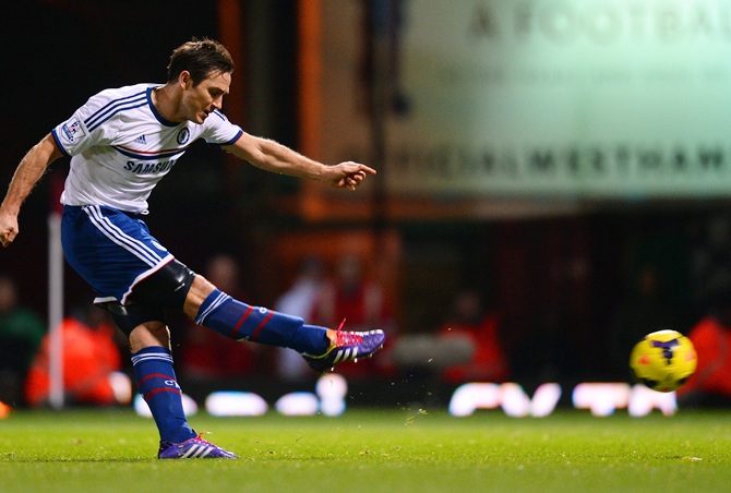Frank Lampard of Chelsea scores the opening goal from the penalty spot