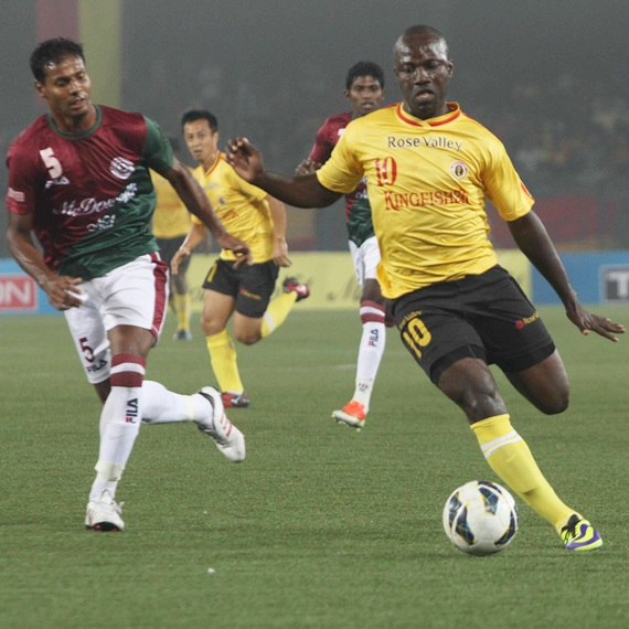 East Bengal forward Edeh Chidi (right) runs past Mohun Bagan defence at a packed Salt Lake Stadium