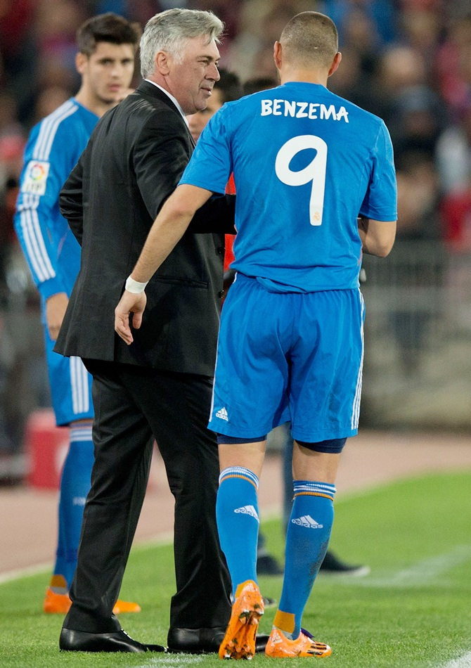 Karim Benzema of Real Madrid CF celebrates scoring their second goal with his head coach Carlo Ancelotti