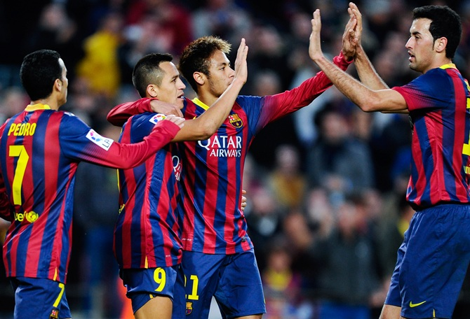 Alexis Sanchez (second left) of FC Barcelona celebrates with his teammates