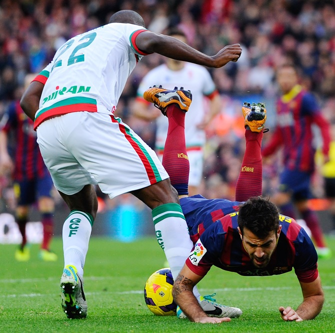Cesc Fabregas of FC Barcelona is brought down by Foulquier for a penalty of Granada CF