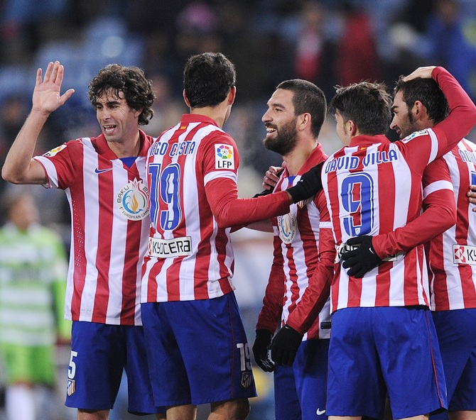 Adrian Lopez (right) of Club Atletico de Madrid celebrates with teammates