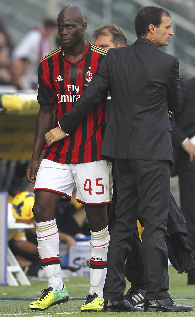 Mario Balotelli (left) of AC Milan is greeted by manager Massimiliano Allegri
