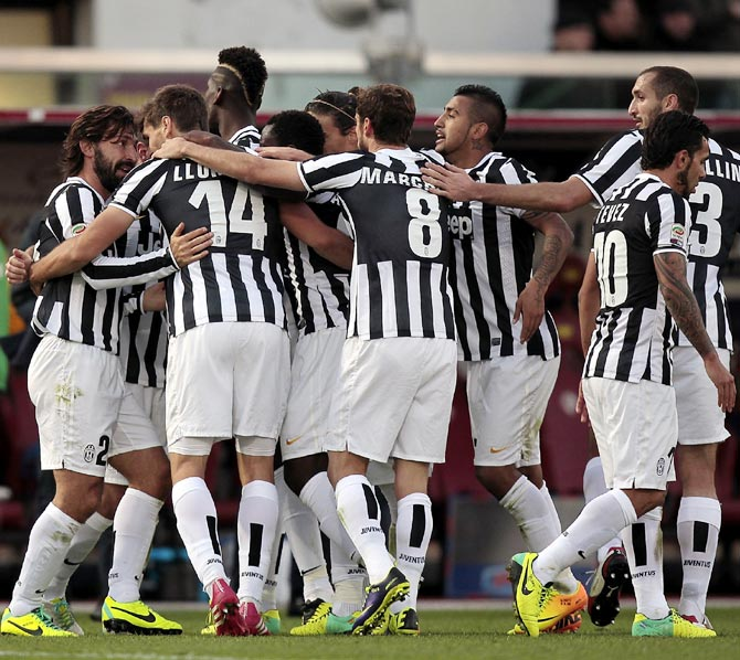 Juventus players celebrate a goal scored by Fernando Llorente