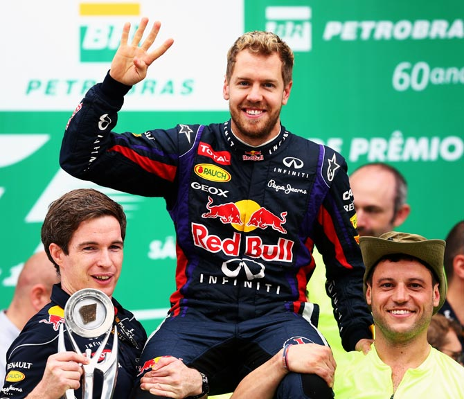 Sebastian Vettel celebrates with Red Bull team after winning the Brazilian Grand Prix
