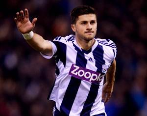 Shane Long of West Bromwich Albion celebrates as he scores their first goal