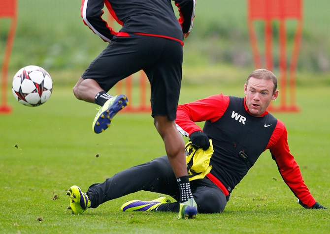 Wayne Rooney (right) of Manchester United in action during a training session