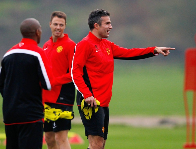 Robin van Persie of Manchester United gestures during a training session