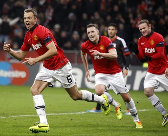 Jonny Evans celebrates after scoring a goal