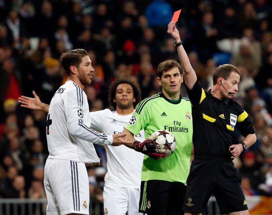 Referee William Collum shows a red card to Real Madrid's Sergio Ramos