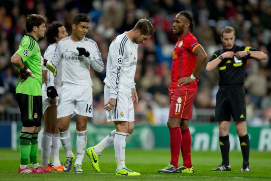 Sergio Ramos of Real Madrid CF leaves the pitch defeated after referee William Collum has shown him the red card