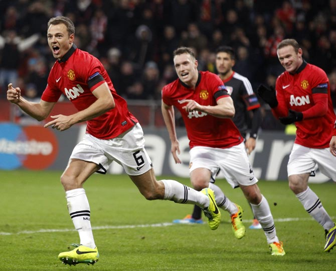 Manchester United's Jonny Evans (left) celebrates after scoring a goal past against Bayer Leverkusen