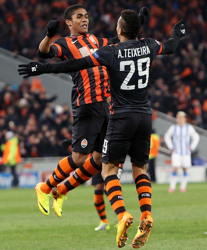 Shakhtar Donetsk's Alex Teixeira and team mate Douglas Costa celebrate a goal