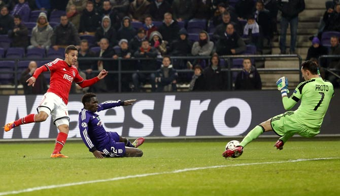 Benfica's Rodrigo (left) scores against Anderlecht