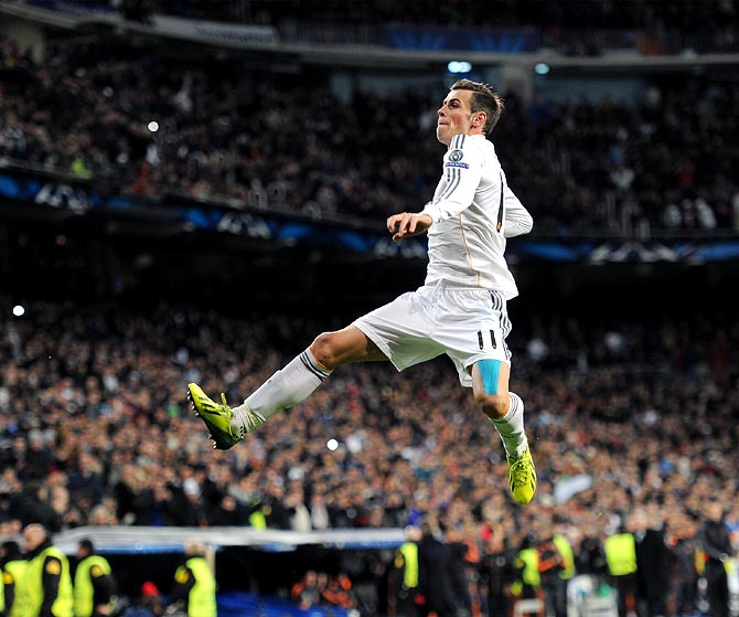 Gareth Bale celebrates scoring the opening goal for Real Madrid