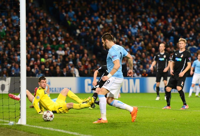 Alvaro Negredo of Manchester City scores his team's third goal