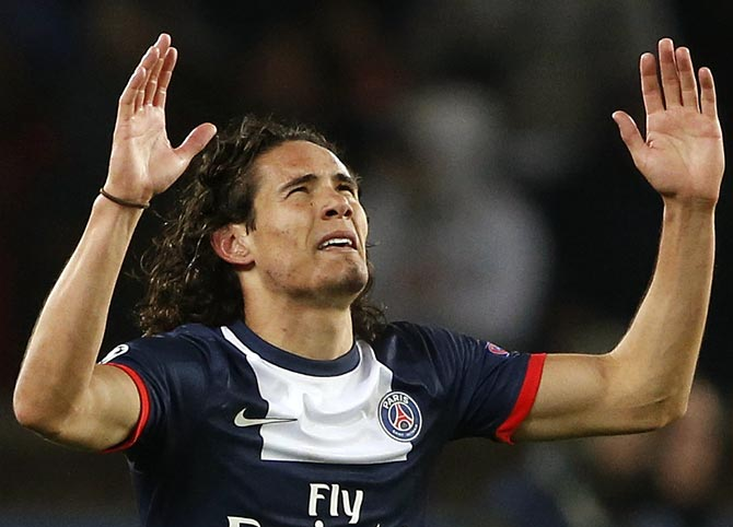 Paris St-Germain's Edinson Cavani celebrates after scoring the second goal