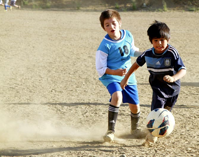 Claudio Nancufil (right) gets the ball past a defender