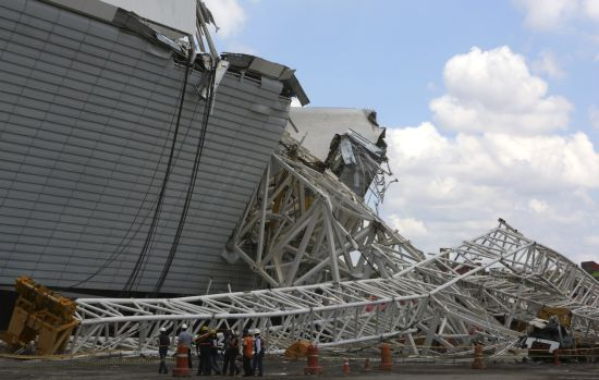 Members of the civil defence arrive to the area where a crane collapsed, on the site of the Arena Sao Paulo stadium