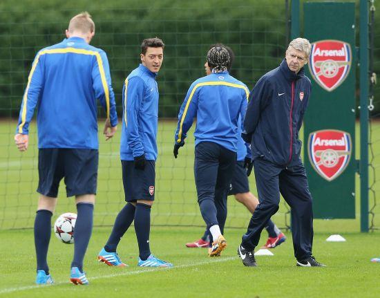 Arsene Wenger and Mesut Ozil