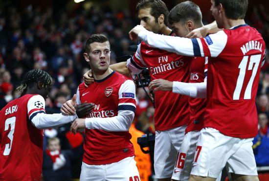 Jack Wilshere celebrates after scoring