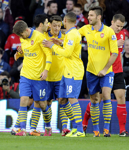 EPL: Ramsey's brace helps Arsenal go seven clear