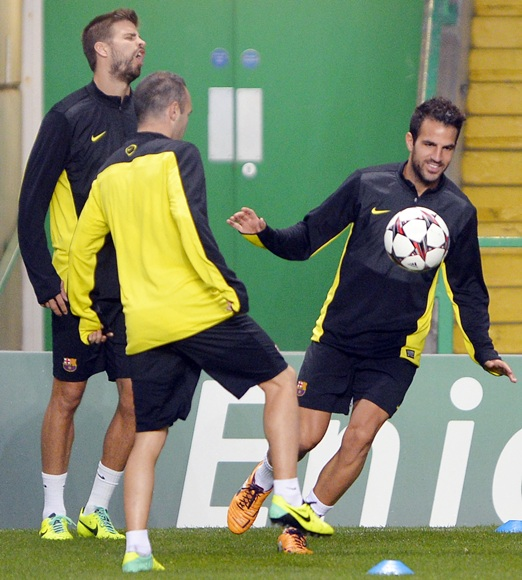 Barcelona's Cesc Fabregas controls the ball during a training session at Celtic Park Stadium in Glasgow