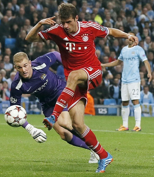 Bayern Munich's Thomas Muller (right) scores during their Champions League match against Manchester City at the Etihad Stadium in Manchester on Wednesday night
