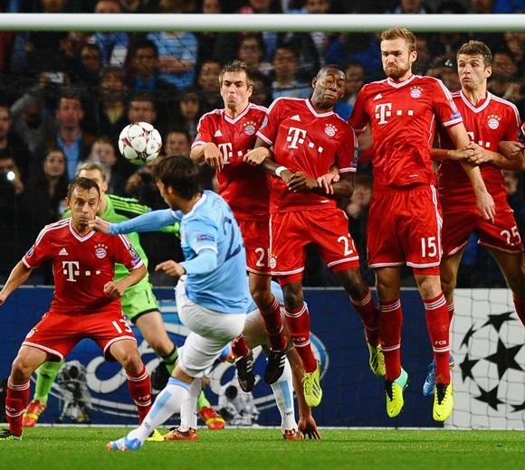 David Silva of Manchester City hits a free kick
