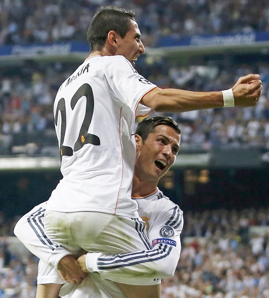 Real Madrid's Angel Di Maria (22) celebrates his goal with with   teammate Cristiano Ronaldo during their Champions League   match against FC Copenhagen at Bernabeu stadium in Madrid on Wednesday night