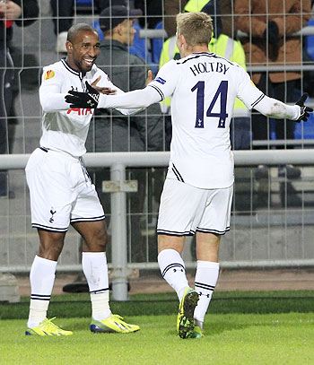 Tottenham Hotspur's Lewis Holtby (right) and Jermain Defoe celebrate a goal scored against Anzhi Makhachkala on Thursday