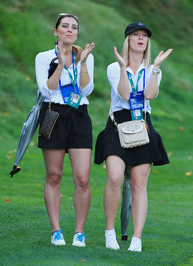 Jason Day's girlfriend Ellie Day (left) and Graham DeLaet's partner Ruby DeLaet watch the play of the International Team during the Day One Four-Ball Matches of the President's Cup at the Muirfield Village Golf Club in Dublin, Ohio, on Thursday