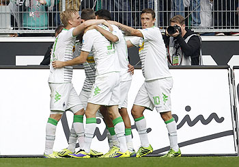 Borussia Moenchengladbach's Max Kruse (right) and teammates celebrate a goal against Borussia Dortmund during their Bundesliga match in Moenchengladbach on Saturday