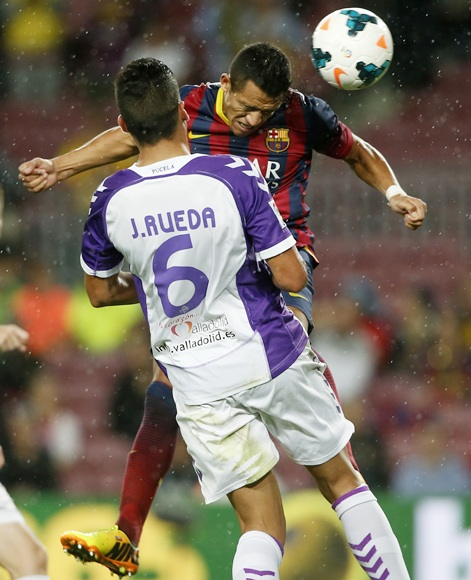 Barcelona's Alexis Sanchez (right) jumps to the head the ball in front of Real Valladolid's Jesus Rueda