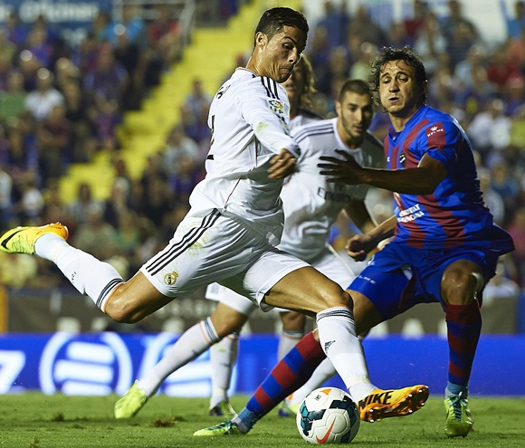 Cristiano Ronaldo (left) of Real Madrid competes for the ball with Hector Rodas of Levante