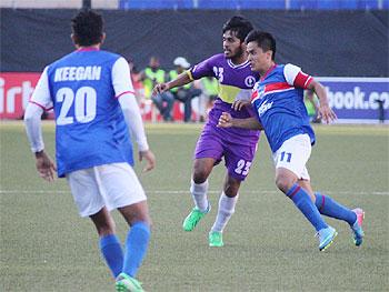 Bengaluru FC's Sunil Chhetri dribbles past the rival defence